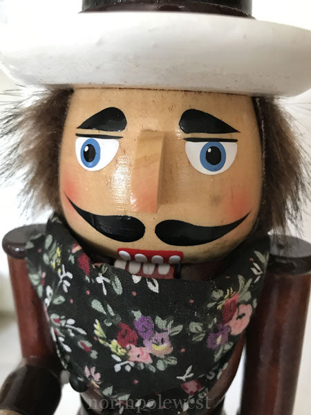Face of Handsome cowboy Christmas Nutcracker with brown shirt and lasso from North Pole West