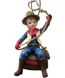 cowboy child on saddle holding rope lasso cowboy Christmas tree ornament