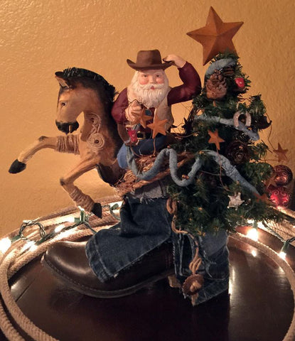 This cowboy Santa and his horse companion are looking to stir up Christmas fun in this repurposed cowboy boot -from North Pole West