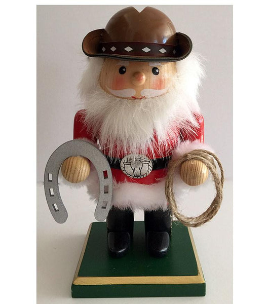 Adorable cowboy Santa western Christmas nutcracker with horseshoe and lasso