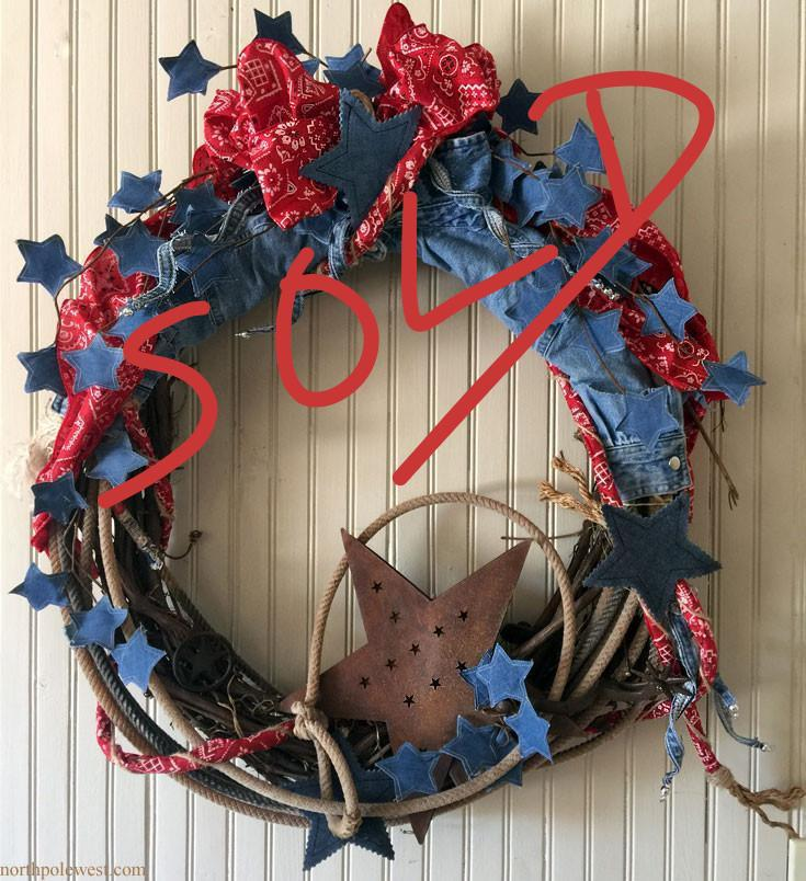 Cowboy country western wreath with denim & rusty stars, spur and authentic lasso. From the No Fences collection of North Pole West