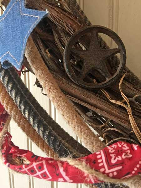 Cowboy country western wreath with denim & rusty stars, spur and authentic lasso.