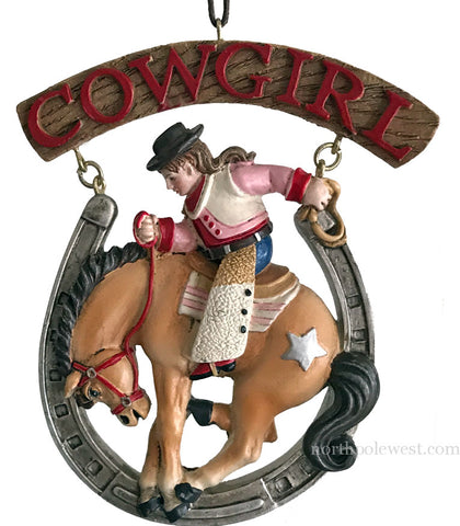 cowgirl bronc rider in horseshoe rodeo cowboy Christmas ornament from North Pole West