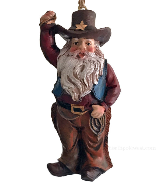 Cowboy Santa holding lasso western Christmas ornament from North Pole West
