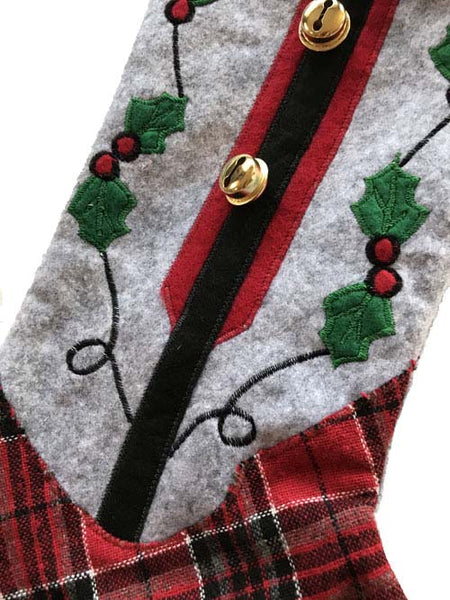 close up view of Grey and red plaid cowboy boot Christmas stocking with holly and  bells from North Pole West
