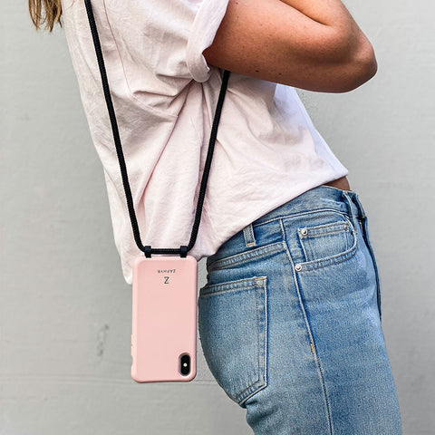 Pink Zaphyr phone case hanging down from shoulder