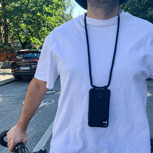 Zaphyr black phone case hanging from boys neck