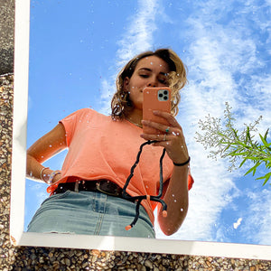 Girl taking selfie in mirror with peach Zaphyr phone case