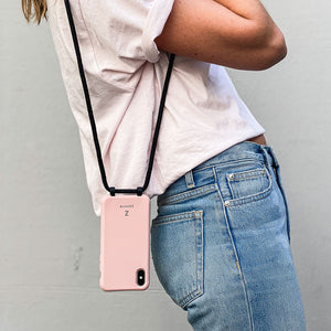 Zaphyr pink phone case hanging down from shoulder