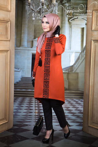 Muslima Wear. Tunic oranj rube color with fancy black embroidery.