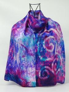 A luxury silk satin scarf in purple, pinks and blends of turquoise and blue