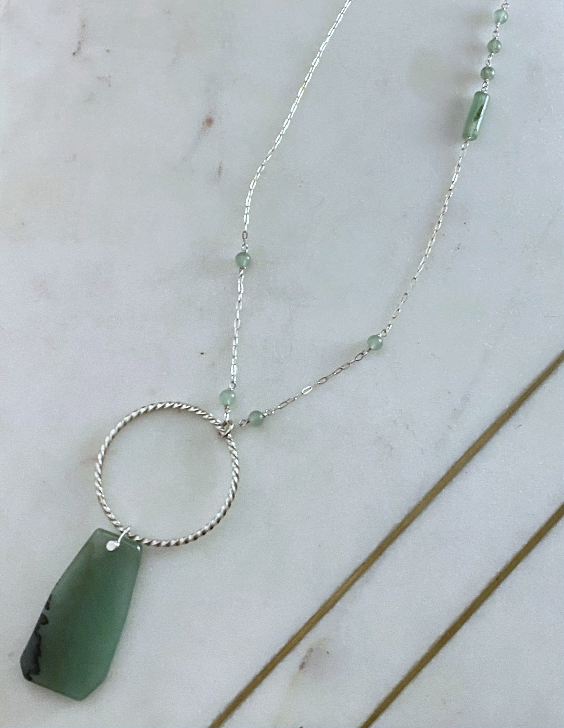Sterling silver twisted and forged hoop with aventurine gemstones necklace