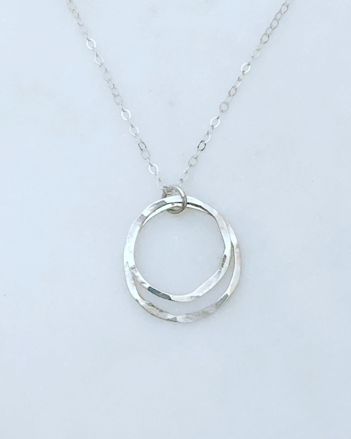 Sterling silver forged double circle necklace
