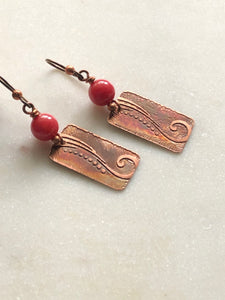 Acid etched copper swirl earrings with coral gemstones