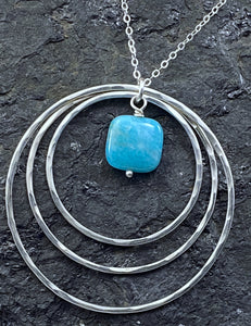 Sterling silver forged circle necklace with apatite gemstone