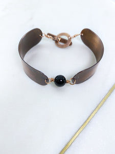 Copper and onyx bracelet