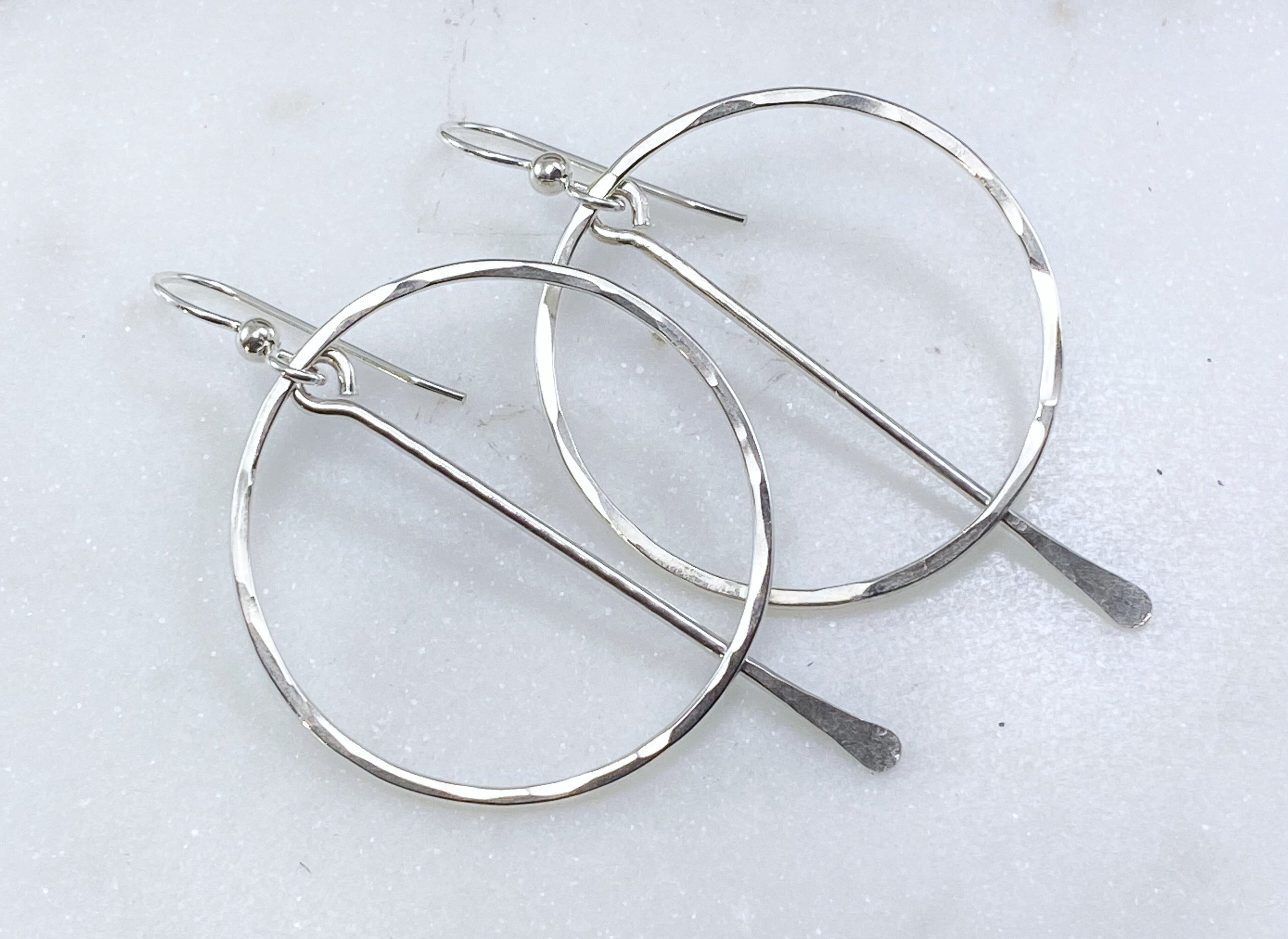 Sterling silver forged hoop earring with sterling paddle