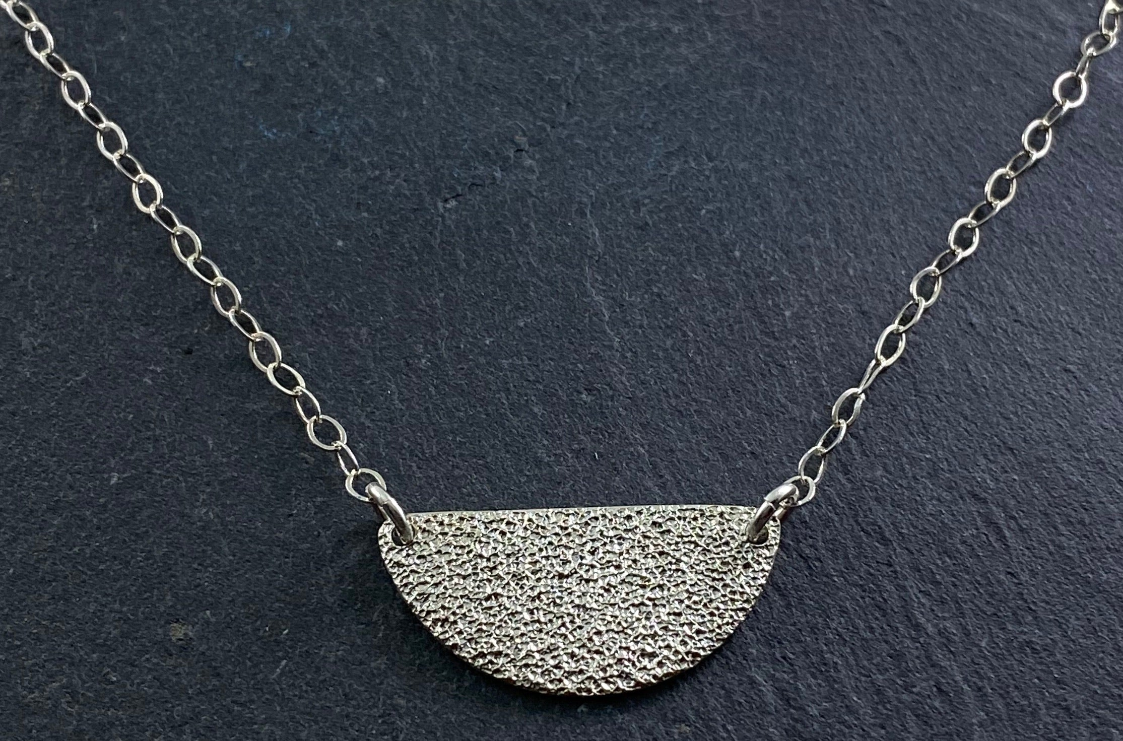 Sterling silver hammer textured half circle necklace