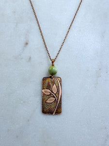 Acid etched copper leaf necklace with green garnet