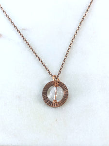 Copper textured circle necklace with quartz