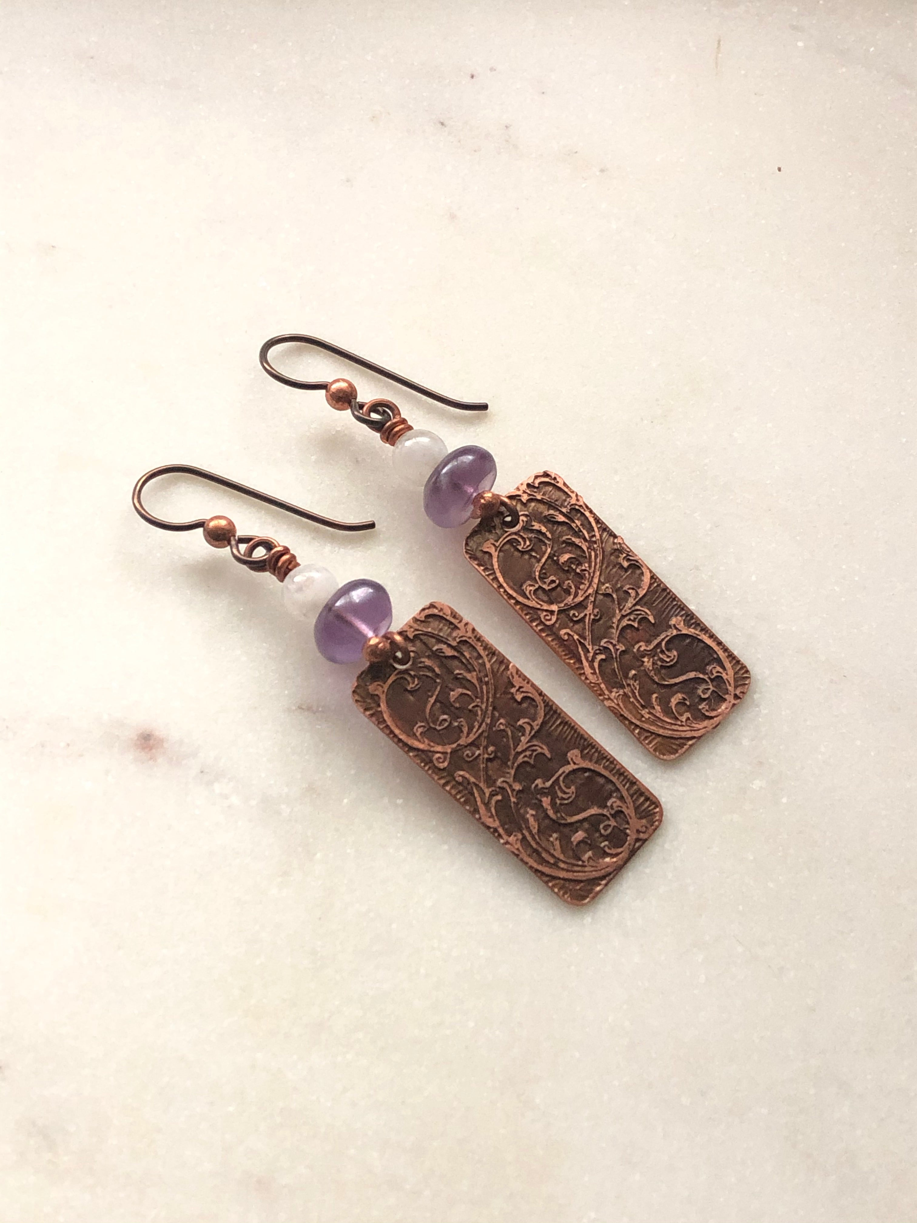 Acid etched copper swirl earrings with amethyst and moonstone gemstones