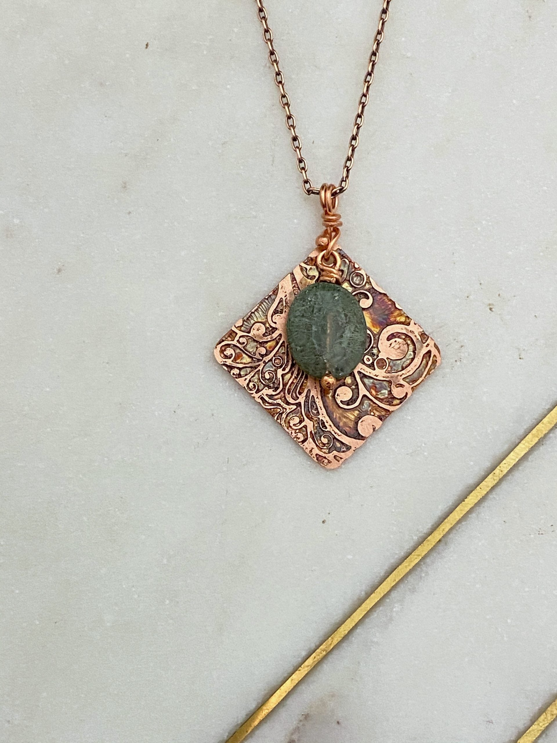 Acid etched copper swirl necklace with fancy jasper