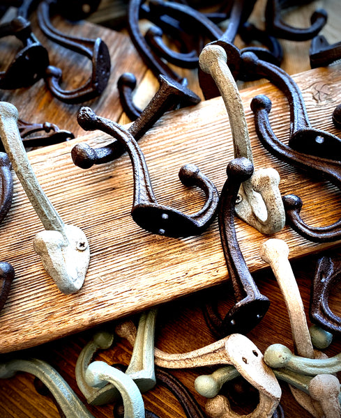 Three Cast Iron Wall Hooks on Reclaimed Barn Wood