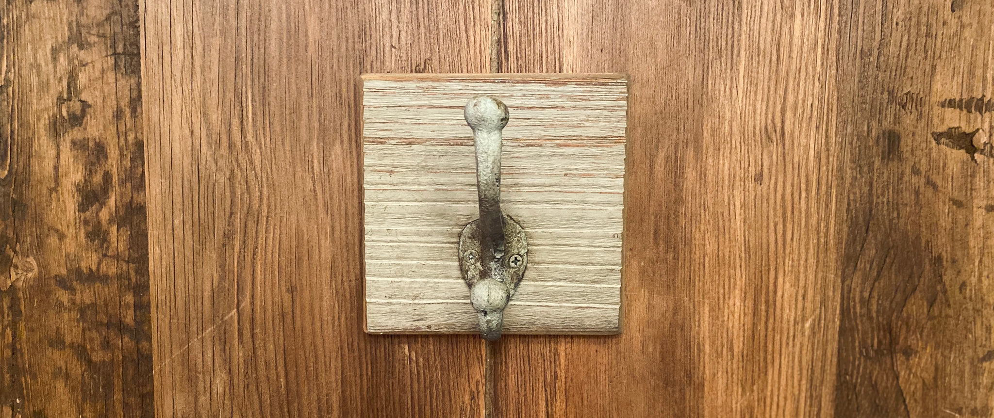 One Cast Iron Wall Hook on Reclaimed Barn Wood