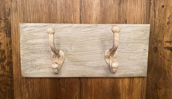 Two Cast Iron Wall Hooks on Reclaimed Barn Wood