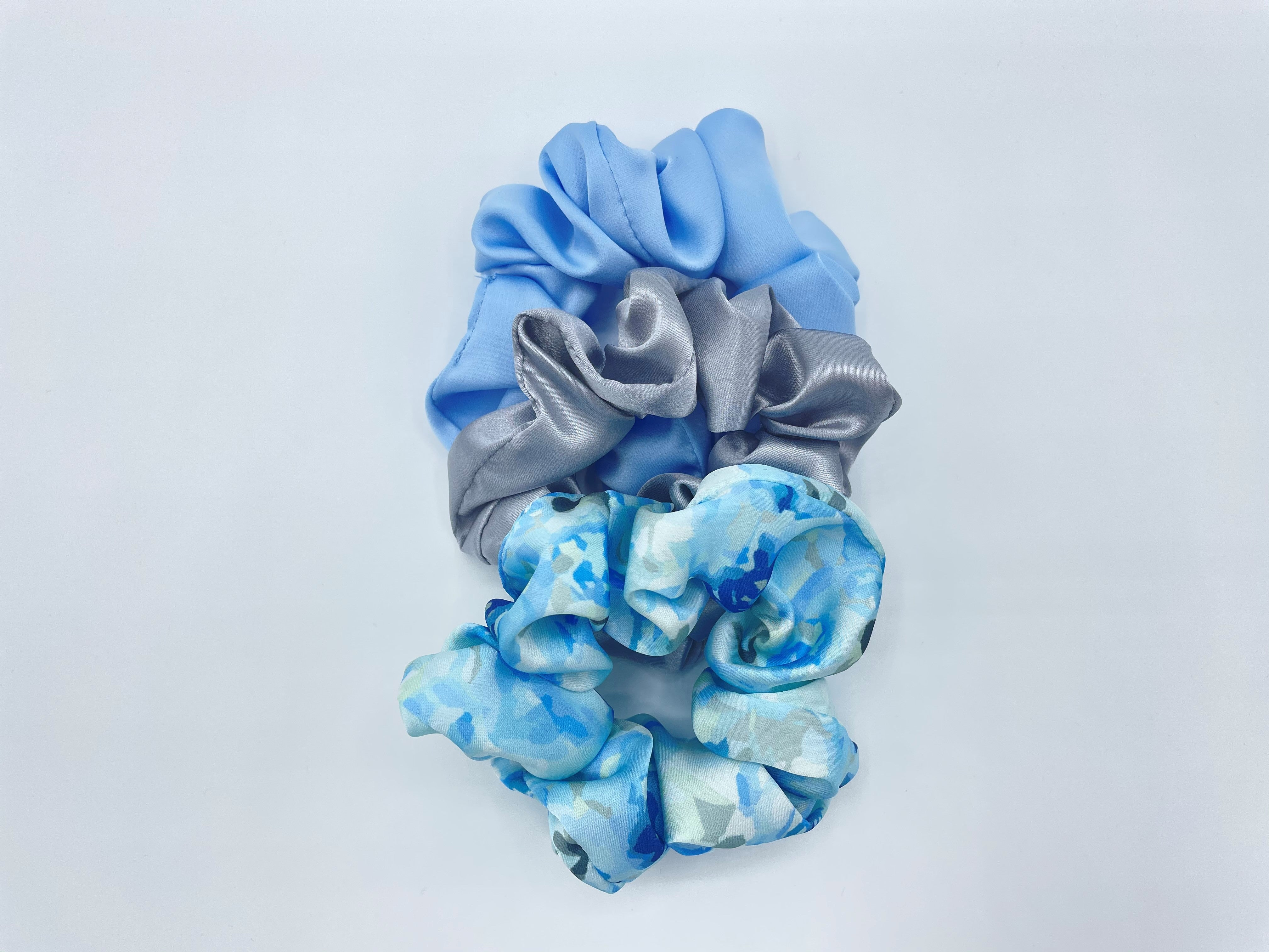 Set of three blue and silver hair scrunchies, made from recycled plastic bottles