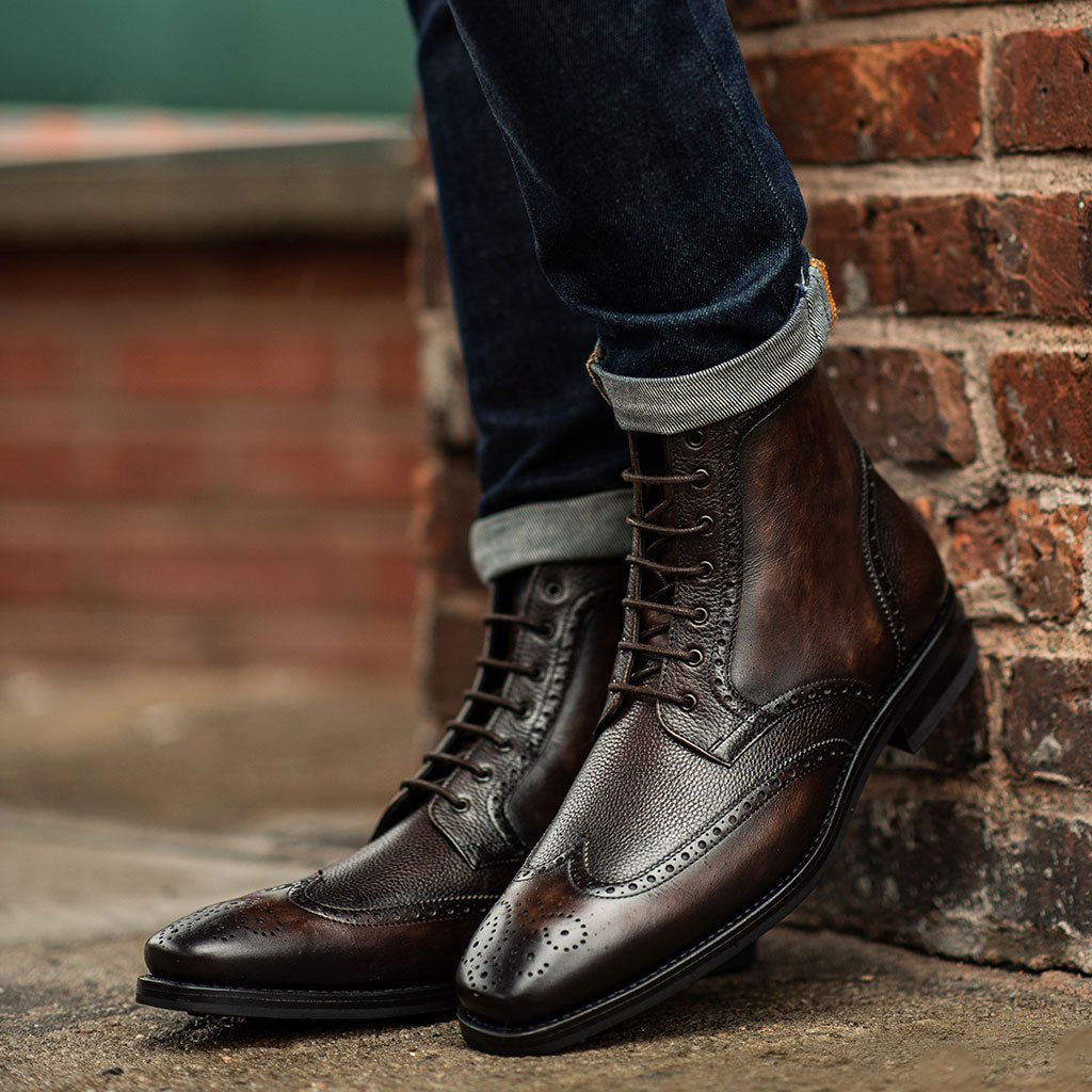 black leather wingtip boots