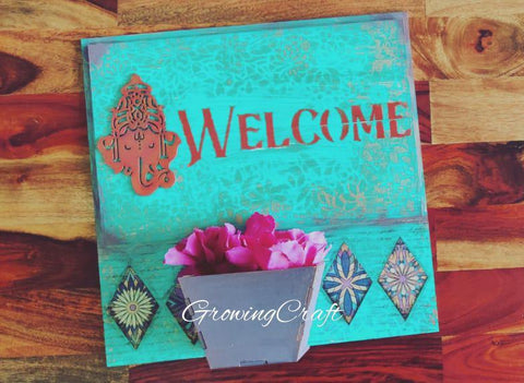 welcome  wall panel with flower vase.