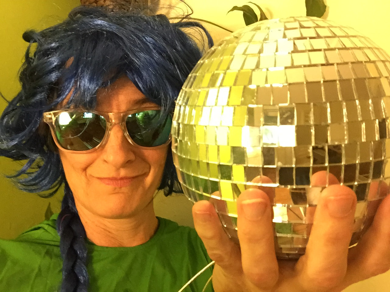 Disco ball and a crazy wig in preparation for exercise class