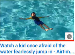 Watch kid fearlessly jump in the water