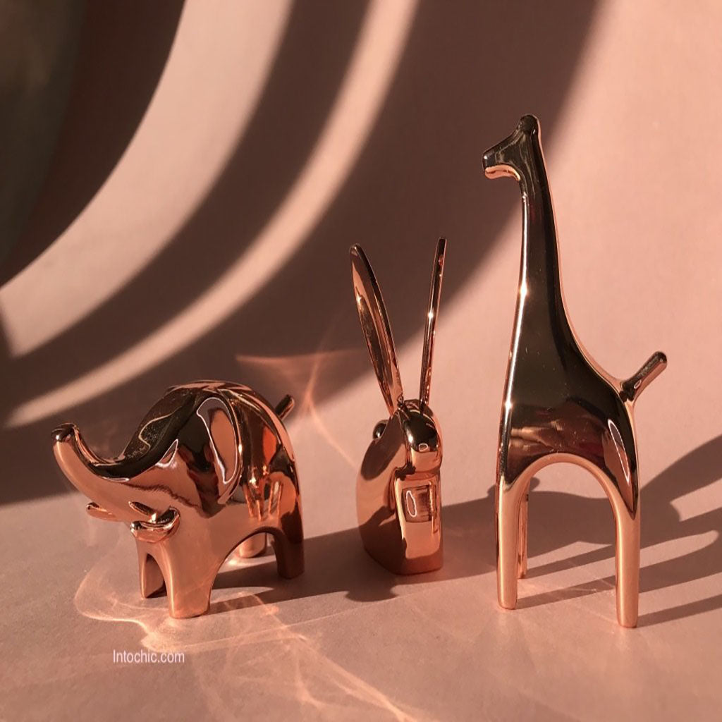 Cooper ring holders in a shape of elephant, giraffe and bunny. Desined by UMBRA