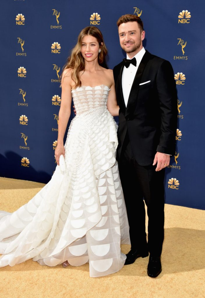 Justin Timberlake and Jessica Biel is wearing a white strapless with cascading ruffles gown by Ralph & Russos, Harry Winston Jewelry and Tyler Ellis Clutch
