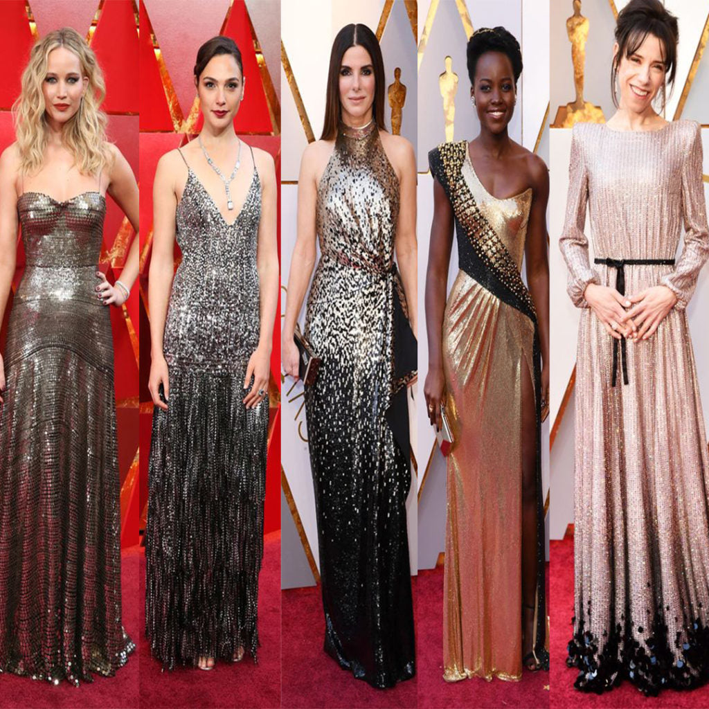 Oscar red carpet. Jennifer Lawrence wore Christian Dior metallic dress, Gal Gadot wore Givenchy Houte Couture dress, Sandra Bullock wore Luis Vuitton gown, Lupita Nyong'o wore Atelier Versace dress and Sally Hawkins wore Armani Privé dress at the academy awards.