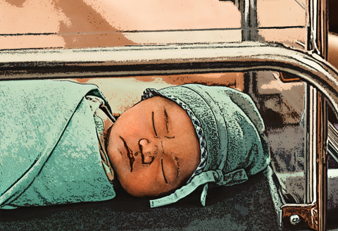 A newborn baby sleeps in the hospital after being born. The baby is edited to have a cartoon effect.
