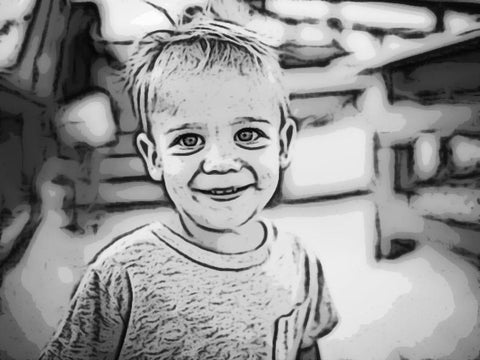 A child is edited by Memories Reimagined to have a cartoon effect. The child is also edited to be black and white.