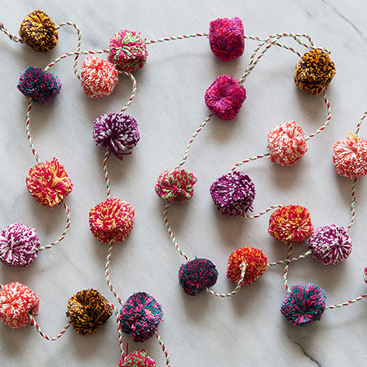 coloured wool pom pom garland