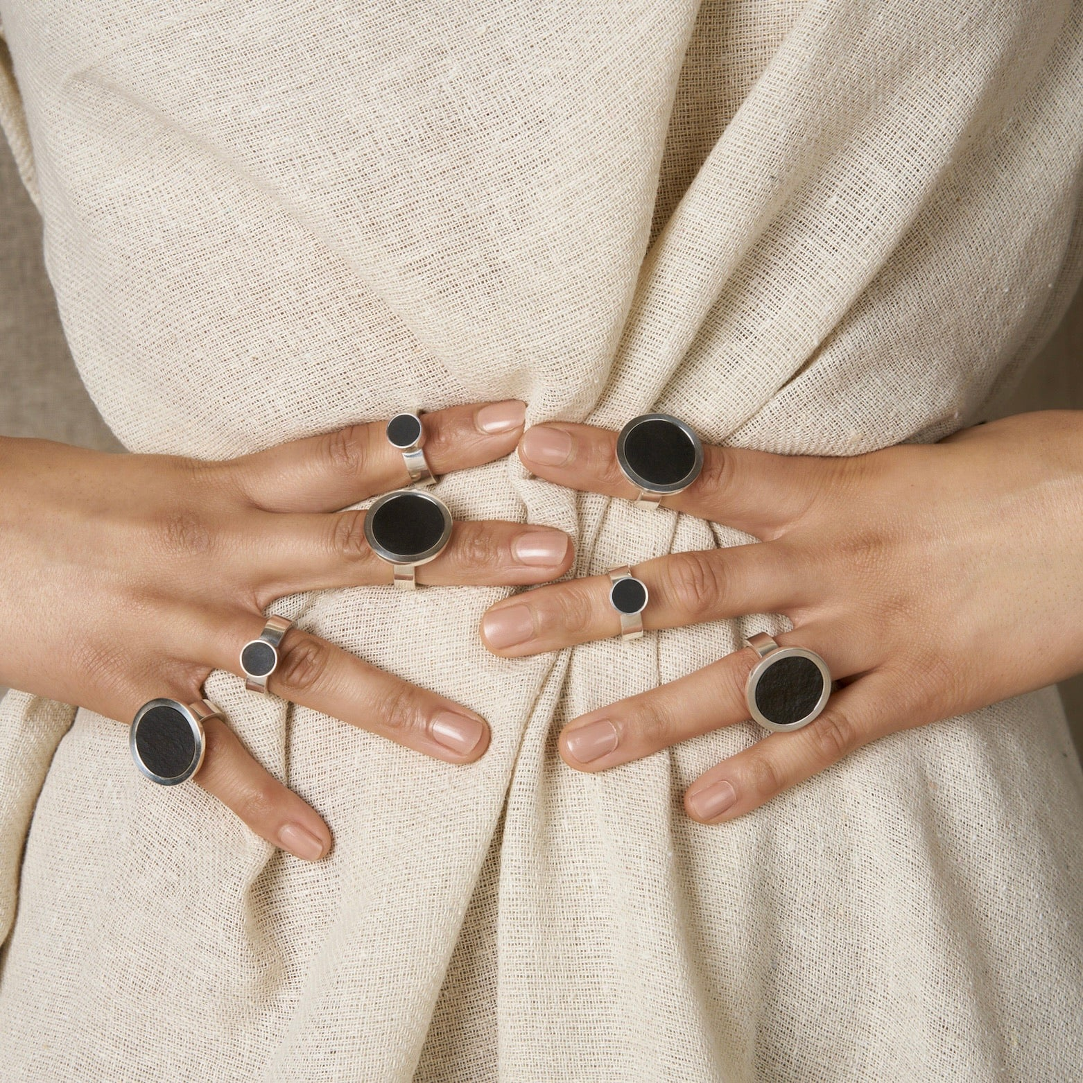 Turið Nolsøe Mohr | Turid Nolsoe Mohr | Black Basalt and Silver Chunky Rings | Stacked Rings Holding Waist Line Pose |  Faroe Islands