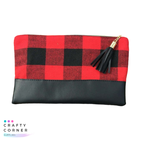 Buffalo plaid clutch with fringe zipper pull