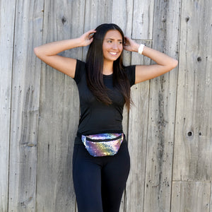 Girl wearing rainbow sequin fanny pack