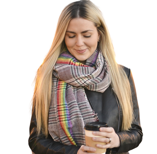 Girl with coffee and rainbow scarf