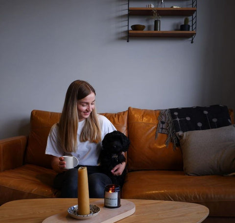 Grace, the owner of Nade Store, and her dog, Dot.