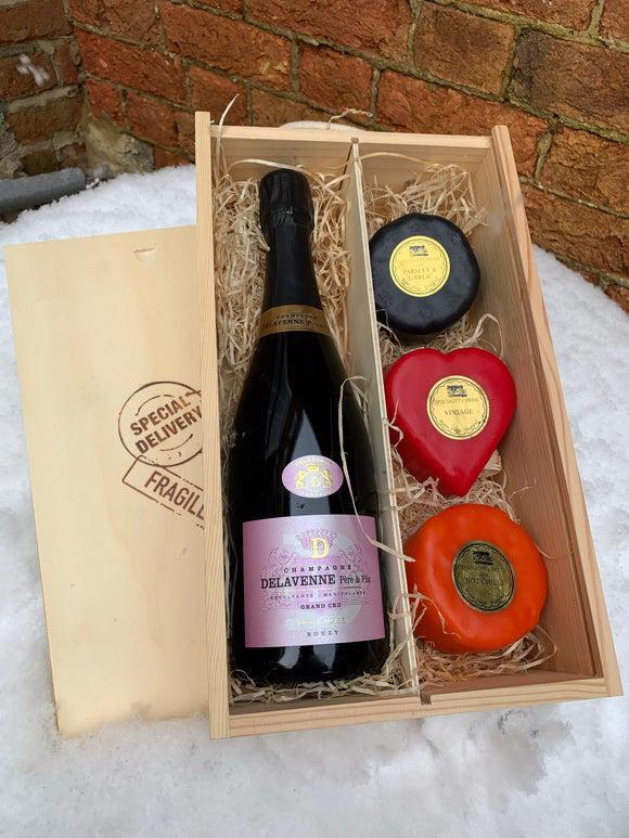 Delavenne Rose Grand Cru Champagne with three cheeses in a wooden box