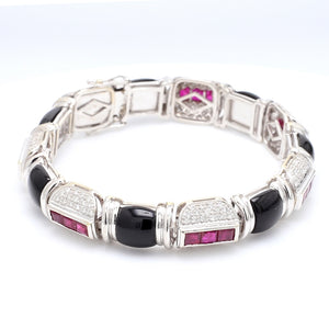 SOLD - 2.25ctw Diamond, Ruby, and Onyx Bracelet