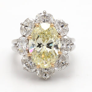 Oscar Heyman, 4.40ct Fancy Yellow VVS1 Oval Cut Diamond Ring - GIA Certified