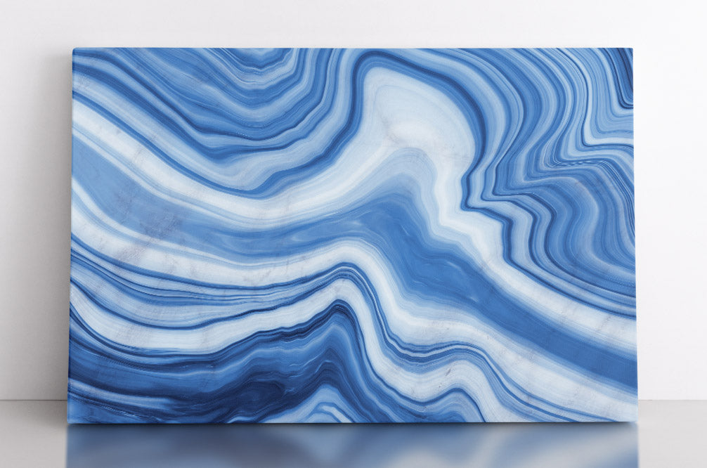 Abstract, pale blue layers of marble or granite with white accents.