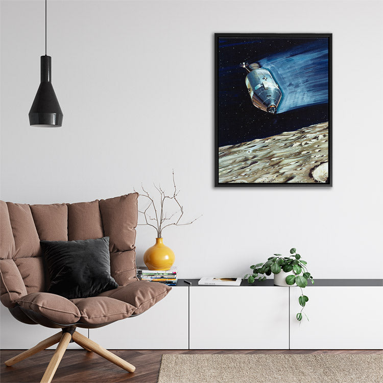 Painting of Apollo 15 spacecraft orbiting the Moon, preparing to land. Framed canvas wall art in room.